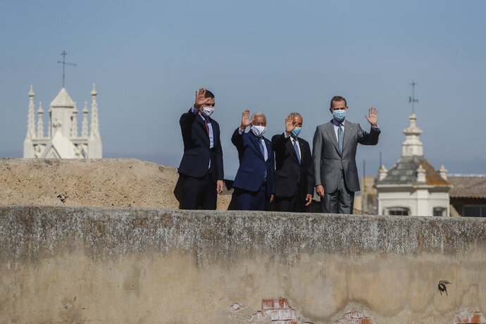 From left to right: Spain's Prime Minister Pedro Sanchez, Portugal's Prime Minister Antonio Costa, Portugal's President Marcelo Rebelo de Sousa and Spain's King Felipe VI during a ceremony to mark the reopening of the Portugal/Spain border in Badajoz, Spain, Wednesday, July 1, 2020. The border was closed for three and a half months due to the coronavirus pandemic. (AP Photo/Armando Franca)