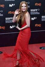U.S. actress Jessica Chastain poses after receiving an ex-aequo Donostia Shell award at the 69th San Sebastian Film Festival, in San Sebastian, northern Spain, Saturday, Sept. 25, 2021. (AP Photo/Alvaro Barrientos)