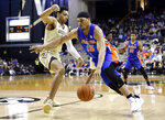 Florida forward Isaiah Stokes (15) drives against Vanderbilt forward Matthew Moyer in the first half of an NCAA college basketball game Wednesday, Feb. 27, 2019, in Nashville, Tenn. (AP Photo/Mark Humphrey)