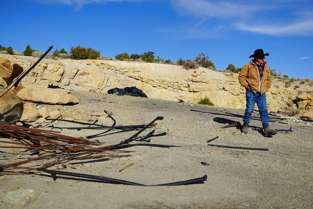 Rancher Mike Wilcox surveys the debris left at the site of the Keystone-Wallace Copper Mill, where he worked briefly in the 1970s on Nov. 12, 2020. Wilcox fears a copper mine's plans to pump diluted sulfuric acid into the shallow aquifer that supplies his well will drive him out of business.  (Zak Podmore/The Salt Lake Tribune via AP)