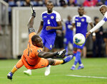 Haiti goalkeeper Jhony Placide (1) fails to stop a shot on goal by Canada midfielder Atiba Hutchinson (13), far right, that was disallowed during the second half of a CONCACAF Gold Cup quarterfinal soccer match Saturday, June 29, 2019, in Houston. (AP Photo/Michael Wyke)