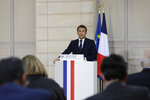 French President Emmanuel Macron speaks during a press conference on the situation in Lebanon, Sunday, Sept.27, 2020 in Paris. Lebanon's prime minister-designate Moustapha Adib resigned Saturday amid a political impasse over government formation, dealing a blow to French President Emmanuel Macron's efforts to break a dangerous stalemate in the crisis-hit country. (AP Photo/Lewis Joly, Pool)