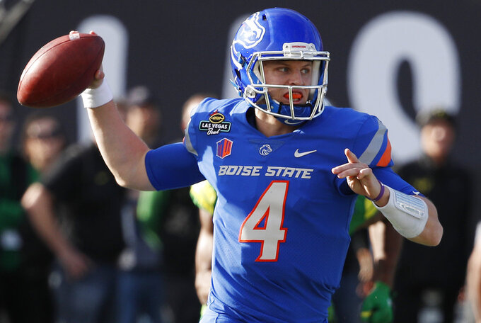 FILE - In this Dec. 16, 2017, file photo, Boise State quarterback Brett Rypien attempts a pass against Oregon during the first half of the Las Vegas Bowl NCAA college football game, in Las Vegas. MWC preseason offensive player of the year Brett Rypien has thrown for 9,876 yards, the highest total of any active Football Bowl Subdivision player. (AP Photo/John Locher, File)