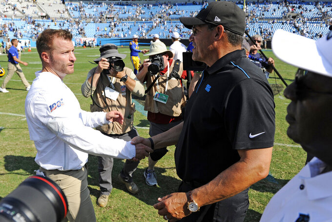 Los Angeles Rams head coach Sean McVay and Carolina Panthers head coach Ron Rivera shake hands following an NFL football game in Charlotte, N.C., Sunday, Sept. 8, 2019. Los Angeles won 30-27. (AP Photo/Mike McCarn)
