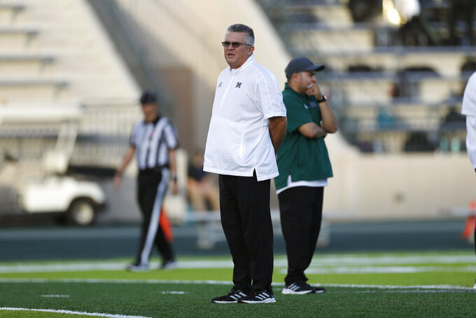 Hawaii head coach Todd Graham, center, is seen before the start of an NCAA college football game against San Jose State, Saturday, Sept. 18, 2021, in Honolulu. (AP Photo/Marco Garcia)