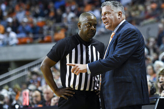 Auburn head coach Bruce Pearl talks to an official during the first half of an NCAA college basketball game against Georgia, Saturday, Jan. 11 2020, in Auburn, Ala. (AP Photo/Julie Bennett)