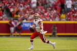 Cleveland Browns quarterback Baker Mayfield drops looks to pass during the first half of an NFL football game against the Kansas City Chiefs Sunday, Sept. 12, 2021, in Kansas City, Mo. (AP Photo/Charlie Riedel)