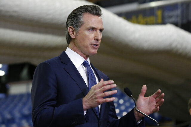 FILE — In this Monday April 6, 2020 file photo, Gov. Gavin Newsom discusses the acquisition of the Sleep Train Arena for use as a field hospital, after touring the facility, in Sacramento, Calif., Newsom announced, Tuesday, April 7, 2020 the state will spend nearly $1 billion to purchase up to 200 million masks per month to boost the state's stockpile of protective equipment during the COVID-19 outbreak and provide as a supplier to other western states. (AP Photo/ (AP Photo/Rich Pedroncelli, Pool, File)