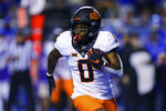 Oklahoma State running back LD Brown carries the ball against Boise State during the first half of an NCAA college football game Saturday, Sept. 18, 2021, in Boise, Idaho. (AP Photo/Steve Conner)