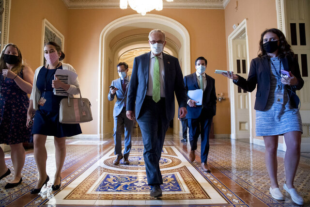 Senate Minority Leader Sen. Chuck Schumer of N.Y. walks to the office of House Speaker Nancy Pelosi of Calif., on Capitol Hill in Washington, Wednesday, July 29, 2020, for a meeting with Pelosi, President Donald Trump's Chief of Staff Mark Meadows, and Treasury Secretary Steven Mnuchin. (AP Photo/Andrew Harnik)