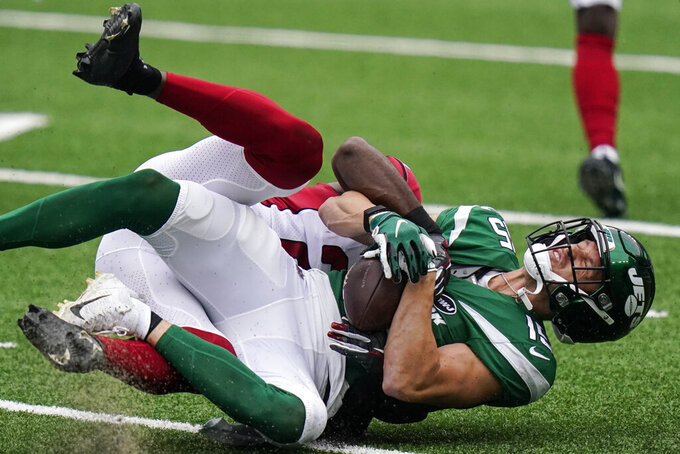 New York Jets wide receiver Chris Hogan (15) is tackled by Arizona Cardinals cornerback Patrick Peterson during the first half of an NFL football game, Sunday, Oct. 11, 2020, in East Rutherford. (AP Photo/Frank Franklin II)