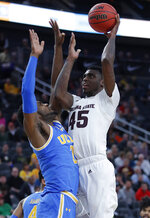 Arizona State's Zylan Cheatham shoots over UCLA's Cody Riley during the second half of an NCAA college basketball game in the quarterfinals of the Pac-12 men's tournament Thursday, March 14, 2019, in Las Vegas. (AP Photo/John Locher)