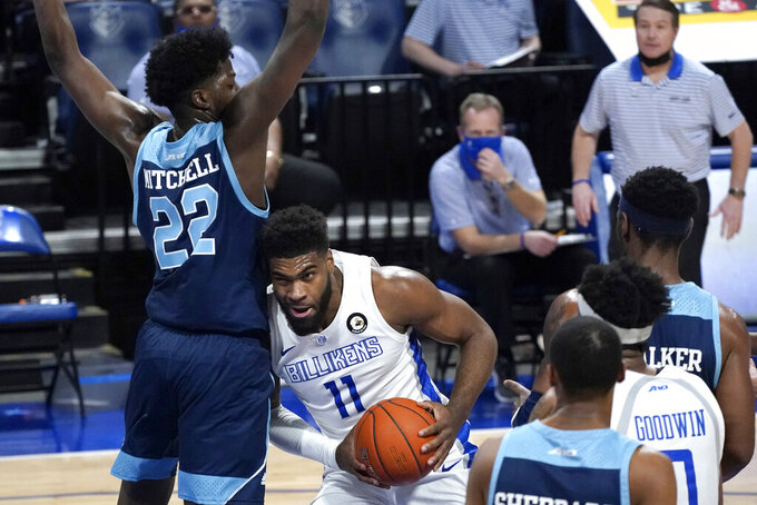 Saint Louis' Hasahn French (11) heads to the basket as Rhode Island's Makhel Mitchell (22) defends during the second half of an NCAA college basketball game Wednesday, Feb. 10, 2021, in St. Louis. (AP Photo/Jeff Roberson)