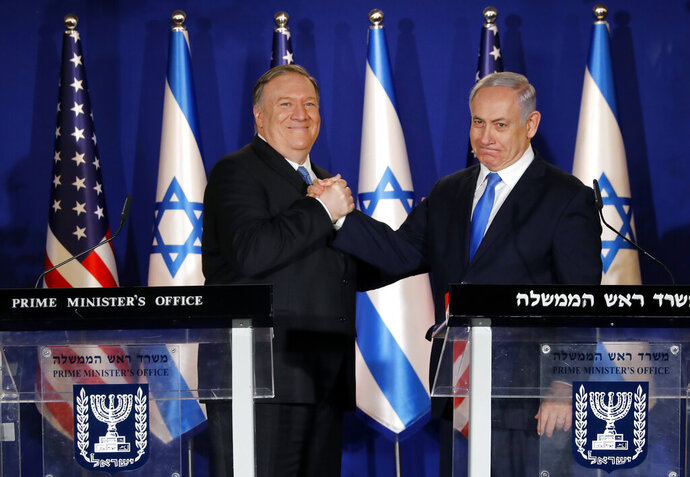 U.S. Secretary of State Mike Pompeo, left, shakes hands with Israeli Prime Minister Benjamin Netanyahu, during their visit to Netanyahu's official residence in Jerusalem, Thursday March 21, 2019. Netanyahu has praised U.S. President Donald Trump's recognition of its control over the Golan Heights as a holiday