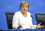 German Chancellor Angela Merkel speaks during a media conference at an EU summit in Brussels, Monday, July 1, 2019. European Union leaders continued a marathon session of talks on Monday desperately seeking a breakthrough in a diplomatic fight over who should be picked for a half dozen of jobs at the top of EU institutions. (AP Photo/Virginia Mayo)
