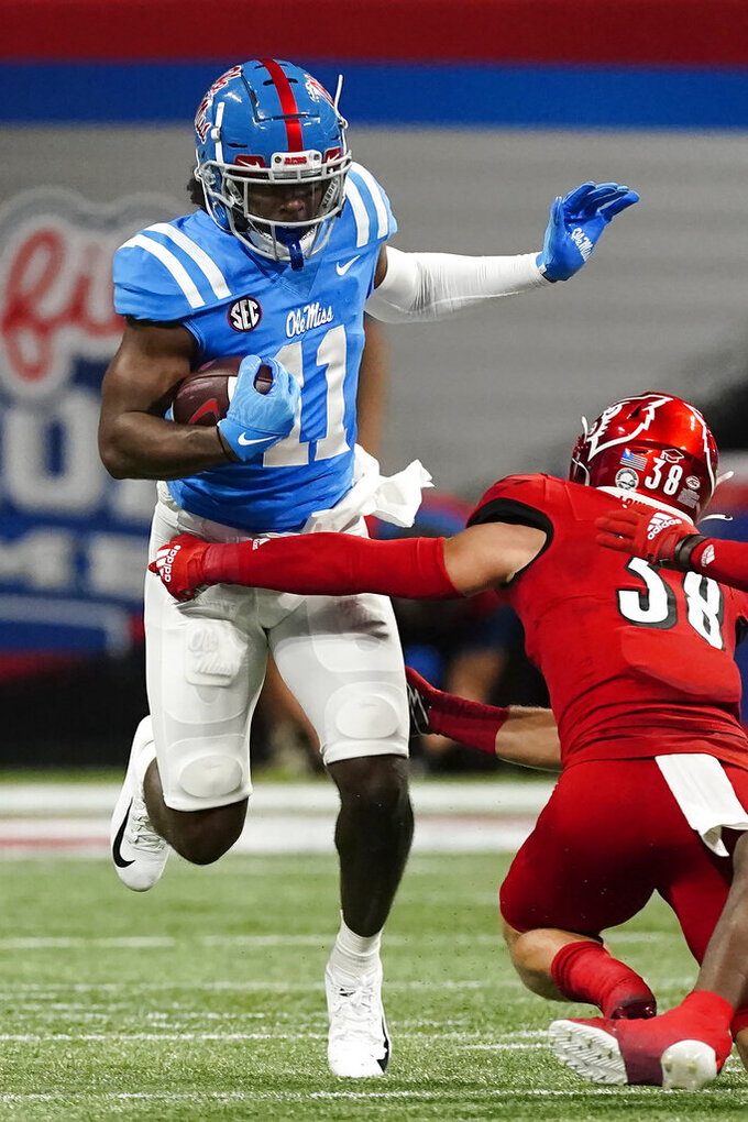 Mississippi wide receiver Dontario Drummond (11) is stopped by Louisville linebacker Jack Fagot (38) Monday, Sept. 6, 2021, in Atlanta, Monday, Sept. 6, 2021, in Atlanta. (AP Photo/John Bazemore)