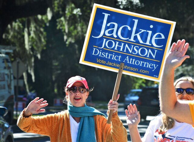 District Attorney Jackie Johnson campaigns for reelection on Tuesday, Nov. 3, 2020, on St. Simons Island, Georgia. Independent challenger Keith Higgins defeated Johnson, a Republican, after she faced criticism for her office's response to the February 2020 killing of Ahmaud Arbery. The 25-year-old Black man was fatally shot by a white father and son who saw him running in their neighborhood. More than two months passed before they were charged in the case. (Terry Dickson/The Brunswick News via AP)