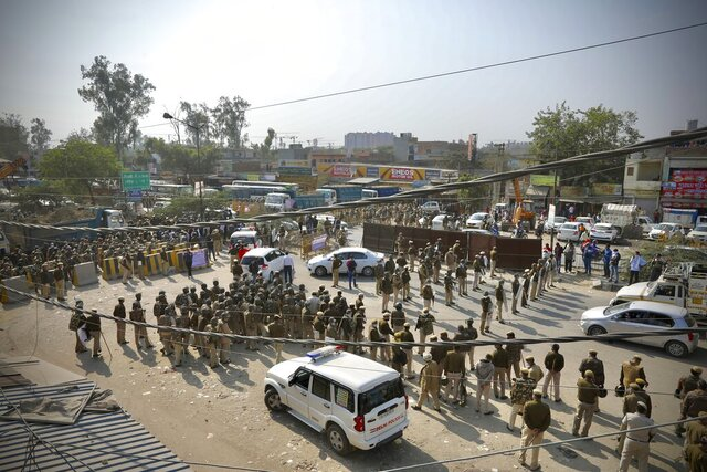 Policemen are deployed at the Haryana-New Delhi border to block protesting farmers from marching to the capital in New Delhi, India, Thursday, Nov.26, 2020. The farmer's have been protesting against the federal agriculture laws. (AP Photo/Manish Swarup)