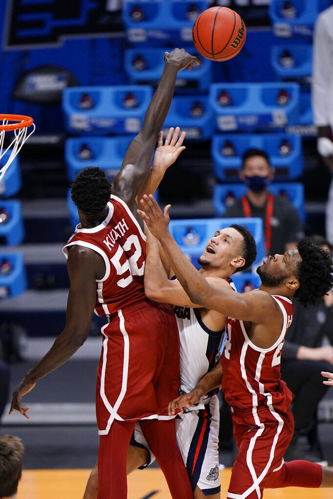 Gonzaga guard Jalen Suggs, middle, gets his shot blocked by Oklahoma forward Kur Kuath (52) in the second half of a college basketball game in the second round of the NCAA tournament at Hinkle Fieldhouse in Indianapolis, Monday, March 22, 2021. (AP Photo/AJ Mast)