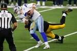 Umpire Dan Ferrell (64) looks on as Pittsburgh Steelers' Cameron Heyward, rear, sacks Dallas Cowboys quarterback Garrett Gilbert (3) in the second half of an NFL football game in Arlington, Texas, Sunday, Nov. 8, 2020. (AP Photo/Michael Ainsworth)