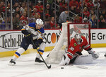 St. Louis Blues right wing Vladimir Tarasenko (91) skates in on Chicago Blackhawks goaltender Cam Ward (30) during the second period of an NHL hockey game Wednesday, April 3, 2019, in Chicago. (AP Photo/David Banks)