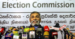 Sri Lanka's elections chief Mahinda Deshapriya speaks during a press conference in Colombo, Sri Lanka, Wednesday, Oct. 16, 2019. Deshapriya says he has asked for an explanation from the defense ministry on why the army commander features in an advertisement promoting a candidate for next month's presidential election. The advertisement, which appeared in a newspaper last weekend, had comments made by Lt. Gen. Shavendra Silva, the current army chief, in 2009 praising presidential candidate Gotabaya Rajapaksa for his role in ending the country's long civil war. (AP Photo/Eranga Jayawardena)