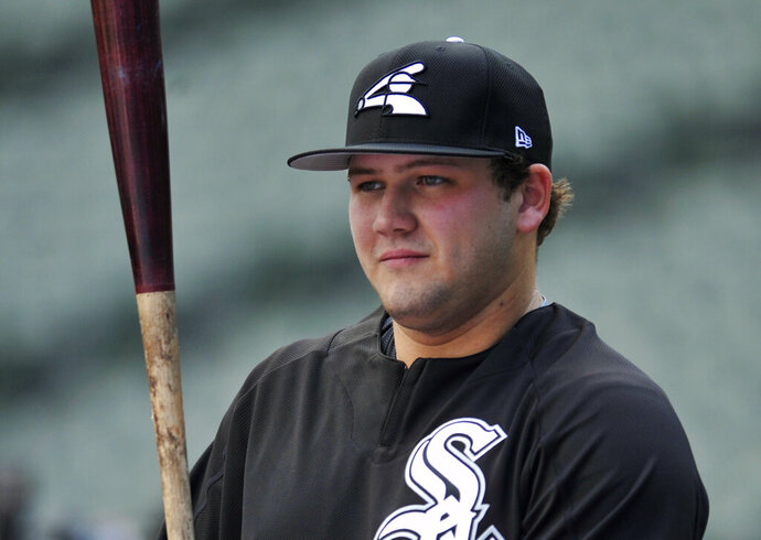 FILE - In this June 26, 2017, file photo, Chicago White Sox's Jake Burger watches during batting practice before the team's baseball game against the New York Yankees in Chicago. Burger is going to play in a local league this summer in his hometown of St. Louis after the White Sox approved the plan for their first-round pick in the 2017 amateur draft. The cancellation of this year's minor league season put prospects like Burger in a tough spot without anywhere to go for game action that could help continue their development. (AP Photo/Paul Beaty, File)