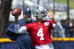 Dallas Cowboys quarterback Dak Prescott throws a pass as coach Mike McCarthy watches during the NFL football team's training camp in Oxnard, Calif., Thursday, July 22, 2021. (AP Photo/Michael Owen Baker)