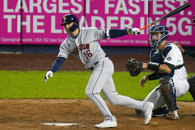 Houston Astros' Aledmys Diaz (16) follows through on a RBI double during the fourth inning of a baseball game Wednesday, May 5, 2021, in New York. (AP Photo/Frank Franklin II)