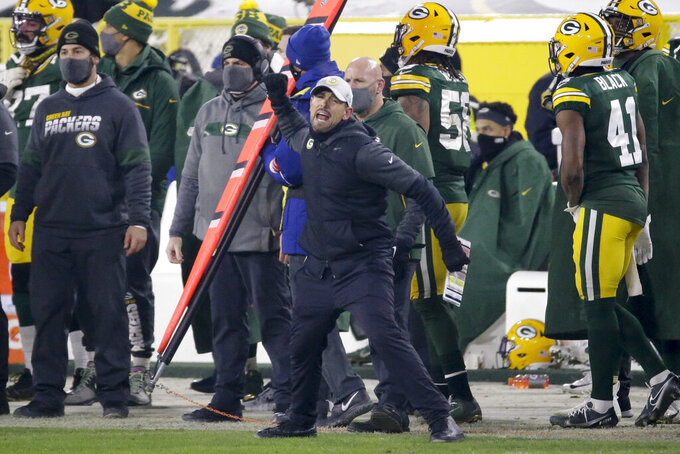 Green Bay Packers head coach Matt LaFleur reacts after a pass interference call was made against Green Bay during the second half of the NFC championship NFL football game against the Tampa Bay Buccaneers in Green Bay, Wis., Sunday, Jan. 24, 2021. (AP Photo/Mike Roemer)