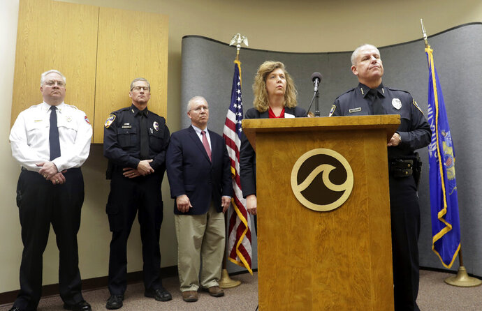 Oshkosh Police Chief Dean Smith and Superintendant of Schools Dr. Vickie Cartwright answer questions durin a press conference following an officer invloved shooting at Oshkosh West High School on Tuesday December 3, 2019, in Oshkosh, Wis. Earlier, police responded to an officer invloved shooting at Oshkosh West High School after an armed student confronted a school resource officer. (Wm. Glasheen/The Post-Crescent via AP)