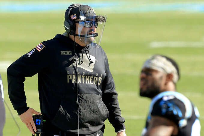 Carolina Panthers head coach Matt Rhule sets up before the first half of an NFL football game between the Carolina Panthers and the Tampa Bay Buccaneers, Sunday, Nov. 15, 2020, in Charlotte , N.C. (AP Photo/Brian Blanco)