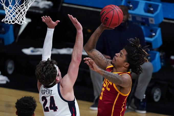 Southern California guard Isaiah White (5) shoots over Gonzaga forward Corey Kispert (24) during the first half of an Elite 8 game in the NCAA men's college basketball tournament at Lucas Oil Stadium, Tuesday, March 30, 2021, in Indianapolis. (AP Photo/Michael Conroy)