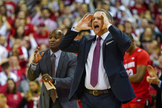 Ohio State head coach Chris Holtmann, right, yells to his his team during the first half of an NCAA college basketball game against Wisconsin, Sunday, Feb. 9, 2020, in Madison, Wis. Wisconsin won 70-57. (AP Photo/Andy Manis)