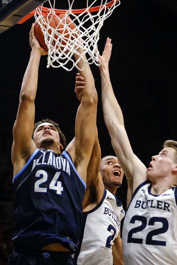 Villanova forward Jeremiah Robinson-Earl (24) is fouled by Butler guard Aaron Thompson (2) while shooting next to Butler forward Sean McDermott (22) during the second half of an NCAA college basketball game in Indianapolis, Wednesday, Feb. 5, 2020. Butler won 79-76. (AP Photo/AJ Mast)