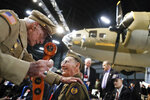 Veterans gather for a private viewing of the Memphis Belle, a Boeing B-17