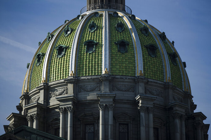 File-This feb. 5, 2019, file photo shows the dome of the Pennsylvania Capitol in Harrisburg, Pa. A bill that would have prohibited abortions because of a prenatal diagnosis of Down syndrome was vetoed Thursday, Nov. 21, 2019,  by Pennsylvania's Democratic governor. One day after it passed the Republican-controlled Legislature, Gov. Tom Wolf made good on a promise and rejected the legislation. (AP Photo/Matt Rourke, File)