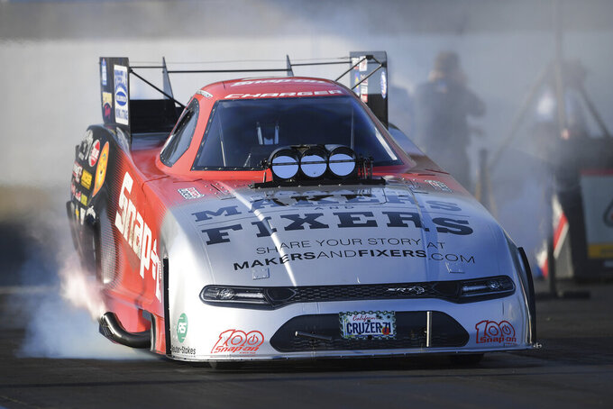 In this photo provided by the NHRA, Cruz Pedregon drives in Funny Car qualifying at the Mopar Express Lane NHRA Nationals drag races Saturday, Sept. 11, 2021, at Maple Grove Raceway in Mohnton, Pa. (Marc Gewertz/NHRA via AP)