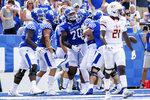 Kentucky celebrates a Brenden Bates' (80) touchdown during the second half of an NCAA college football game against Louisiana-Monroe in Lexington, Ky., Saturday, Sept. 4, 2021. (AP Photo/Michael Clubb)