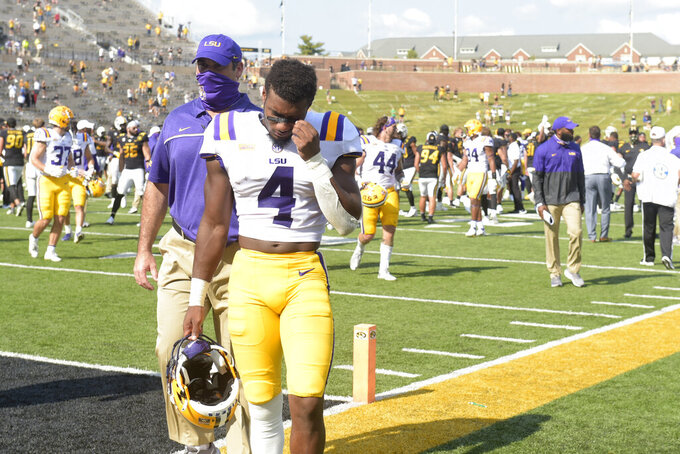 LSU safety Todd Harris Jr. walks off the field following a 45-41 upset loss to Missouri in an NCAA college football game Saturday, Oct. 10, 2020, in Columbia, Mo. (AP Photo/L.G. Patterson)