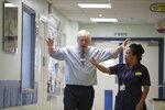Britain's Prime Minister Boris Johnson visits Whipps Cross University Hospital in Leytonstone, east London, Wednesday Sept. 18, 2019. (Yui Mok/Pool via AP)