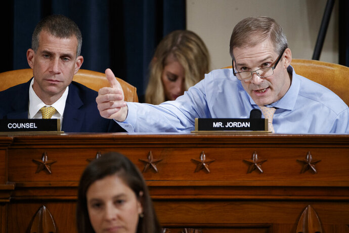 Rep. Jim Jordan, R-Ohio, right, questions Jennifer Williams, an aide to Vice President Mike Pence, and National Security Council aide Lt. Col. Alexander Vindman, as they testify before the House Intelligence Committee on Capitol Hill in Washington, Tuesday, Nov. 19, 2019, during a public impeachment hearing of President Donald Trump's efforts to tie U.S. aid for Ukraine to investigations of his political opponents. Seated to the left looking on is Steve Castor, the Republican staff attorney. (Shawn Thew/Pool Photo via AP)