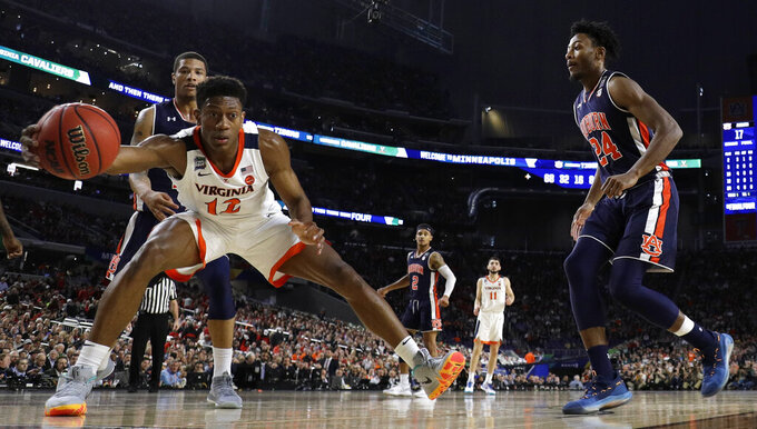 Virginia guard De'Andre Hunter (12) picks up a loose ball in front of Auburn forward Anfernee McLemore, right, during the first half in the semifinals of the Final Four NCAA college basketball tournament, Saturday, April 6, 2019, in Minneapolis. (AP Photo/Jeff Roberson)