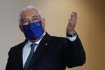 Portuguese Prime Minister Antonio Costa gestures after a group photo with EU Commissioners in Lisbon, Friday, Jan. 15, 2021. The Portuguese government has considered