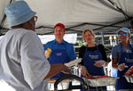 Supreme Court nominee Brett Kavanaugh, second from left, serves macaroni and cheese to the homeless as he volunteers with Catholic Charities, Wednesday, July 11, 2018 in Washington. (AP Photo/Alex Brandon)