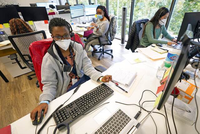 Contact tracers, from left to right, Christella Uwera, Dishell Freeman and Alejandra Camarillo work at Harris County Public Health contact tracing facility Thursday, June 25, 2020, in Houston. Texas Gov. Greg Abbott said Wednesday that the state is facing a