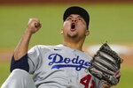 Los Angeles Dodgers starting pitcher Brusdar Graterol reacts after the last out against the Tampa Bay Rays in the eighth inning in Game 4 of the baseball World Series Saturday, Oct. 24, 2020, in Arlington, Texas. (AP Photo/Eric Gay)