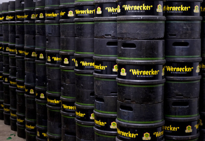In this , Friday, April 17, 2020 photo beer barrels of the Wernecker Brewery are stacked at the brewery in Werneck, Germany. Due to the impact of the coronavirus the traditional brewery has to close 400 years after its foundation. (AP Photo/Michael Probst)