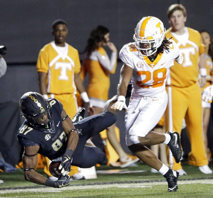 Vanderbilt wide receiver Amir Abdur-Rahman (87) catches a 26-yard touchdown pass as he is defended by Tennessee defensive back Baylen Buchanan (28) in the second half of an NCAA college football game Saturday, Nov. 24, 2018, in Nashville, Tenn. (AP Photo/Mark Humphrey)