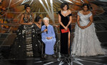 FILE - In this Feb. 26, 2017, file photo Janelle Monae, left, Taraji P. Henson, second right and Octavia Spencer, right, introduce Katherine Johnson, seated, the inspiration for